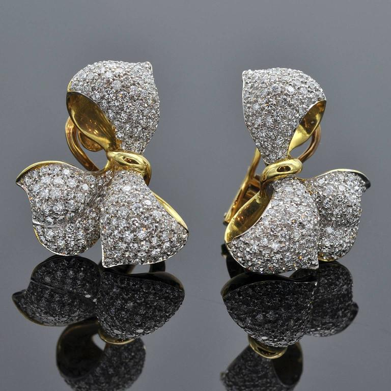 Clip-on Earring in a shape of an elegant bow set with 5.26 carat of diamonds.  Makes a perfect set with Matching Ring Ref: LU47232880723
