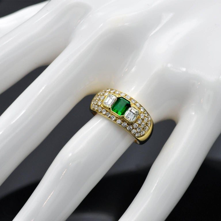 Contemporary Emerald and Diamond Yellow Gold Ring For Sale