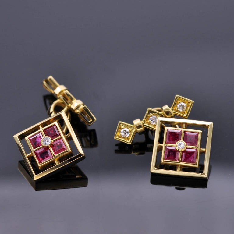 Four square rubies with a diamond nested in their midst in a square classy design. On the back to hold the cufflink in place three diamonds are set in three squares. excellent work.  french hallmark
