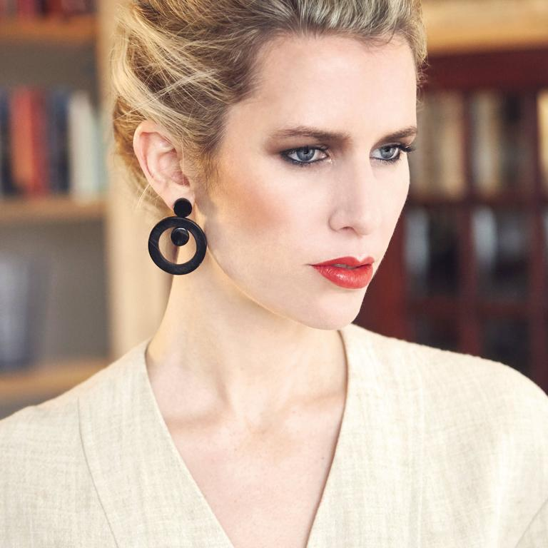 These unique earrings are hand crafted from African cow horn. The design is inspired by Art Deco buildings in Africa.   Earrings come with solid silver pin-backs. Please note that horn inclusions and slight irregularities may occur.   The Fouché