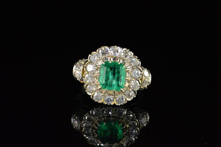 Late Victorian  1.68 Carat Emerald 1.32 Carats Mine Cut Diamonds Gold Ring For Sale