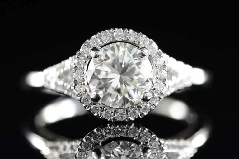 All diamonds are graded according to GIA grading standards.  ·Item: Platinum 0.91 Ct I/VVS2 Round 1.16 Ctw Diamond Halo Engagement Ring Size 4.5  ·Era: Modern / 2000s  ·Composition: Platinum Marked/Tested  ·Gem Stone: 0.91 Ct I Color / VVS2