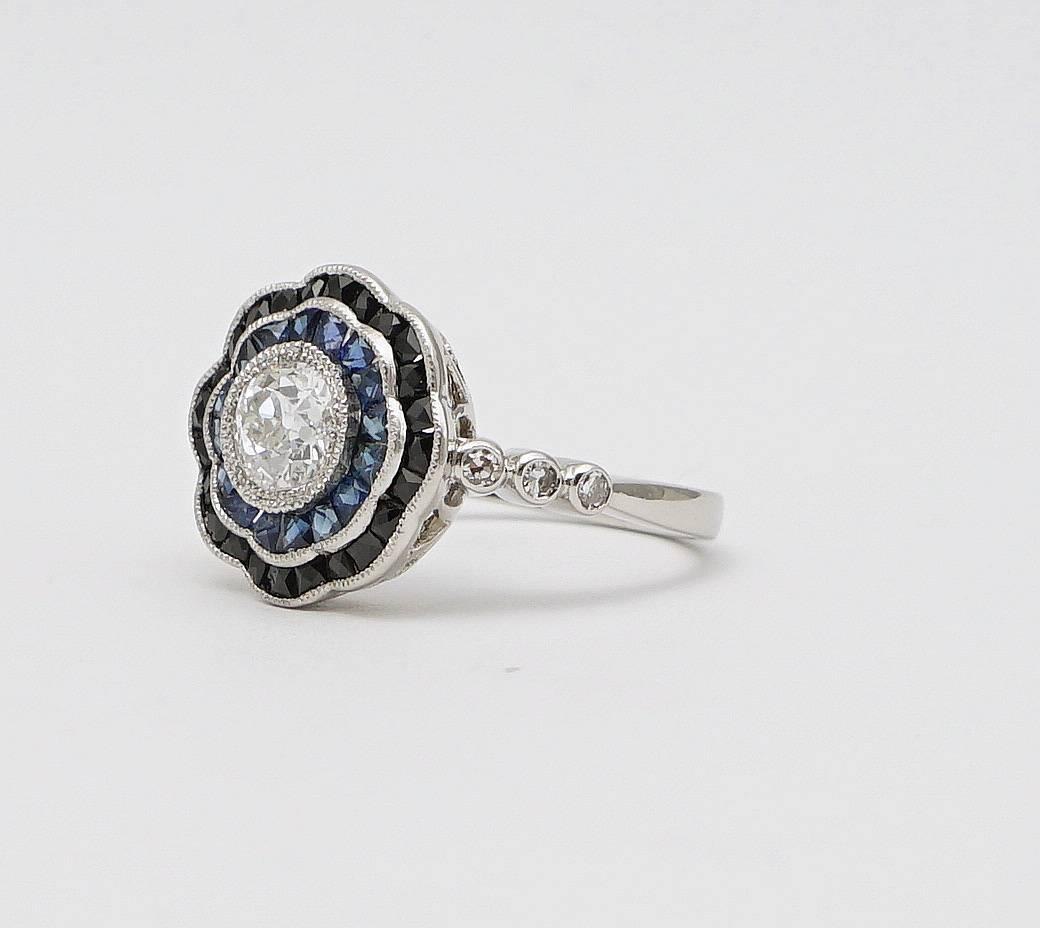 dramatic onyx sapphire platinum engagement ring