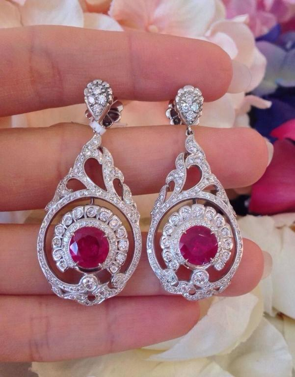 ONE-OF-A-KIND AGL CERTIFIED NO HEAT RUBY DIAMOND DROP EARRINGS HANDCRAFTED IN 18K WHITE GOLD  Showcasing two round shape rubies with vibrant and lively red color.  The Rubies are Certified AGL  No-heat   (*please see AGL cert in photo gallery