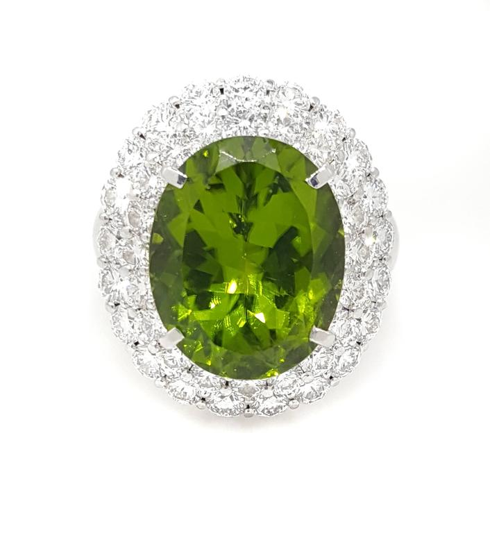 Large Oval Peridot Diamond Platinum Halo Ring For Sale 3