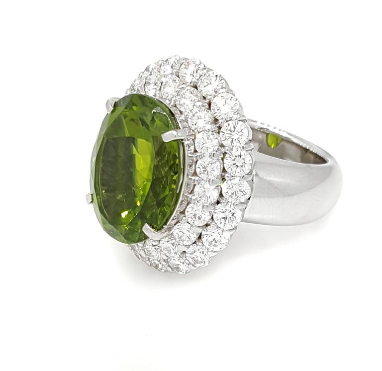 Large Oval Peridot Diamond Platinum Halo Ring In Excellent Condition For Sale In La Jolla, CA