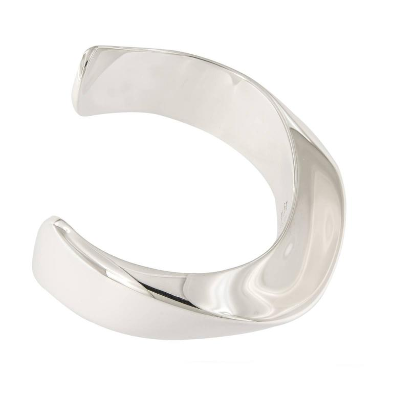 This Cuff bracelet is contemporary and classic Elsa Peretti design. Weighs 39.7 grams. Inner Diameter 2.25 in x 1.75 in  Marked Tiffany & Co.