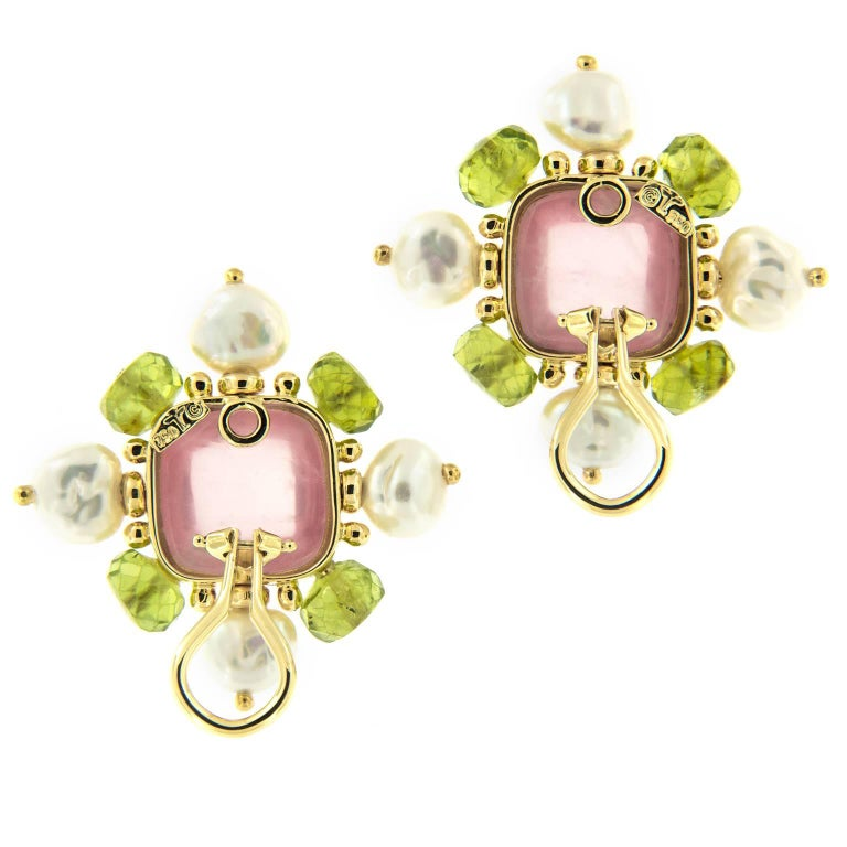 Creating original jewels with unusual combinations of precious and exotic materials has been the hallmark of Trianon jewelry. These beautiful earrings are comprised of a rose quartz center cabachon with 8-6 mm faceted peridots and pearls set in 18k