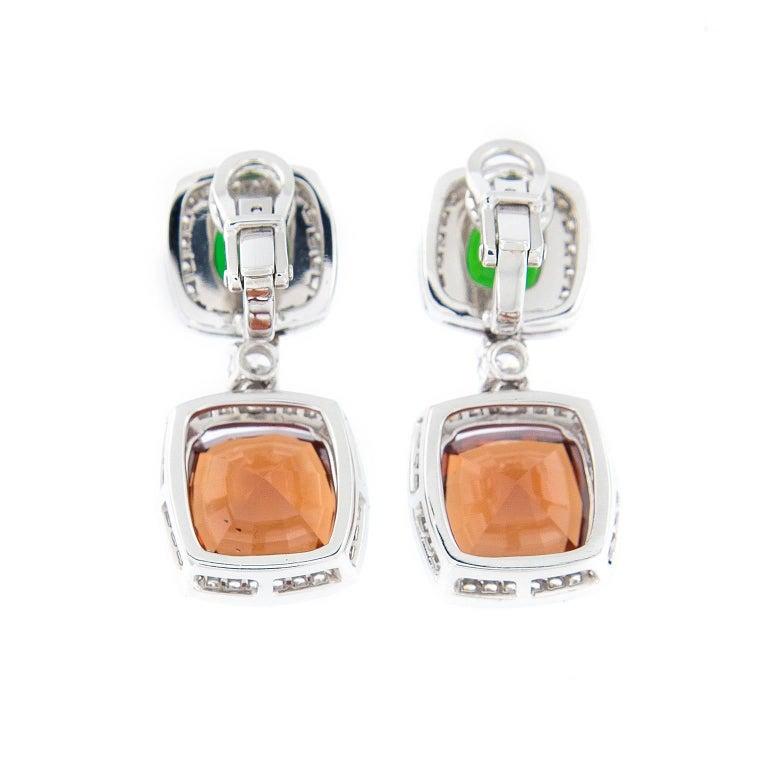 Glamorous double drop earrings with malaya garnets, green tourmaline and Diamonds. Handcrafted in New York. Weigh 11.6 grams.  Malaya garnet  11.04 cttw Green Tourmaline 2.12 cttw Diamond 1.13 cttw
