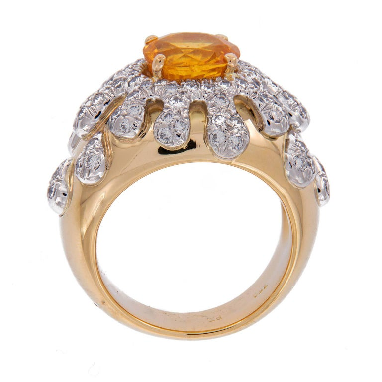 "Gumuchian 18k yellow gold ring from the Splash  Collection centers around a yellow sapphire accented with a diamond ""splash design"" Weighs 16.6 grams. Ring Size 5.25  Yellow Sapphire 1.60 ct Diamonds 0.90 cttw"