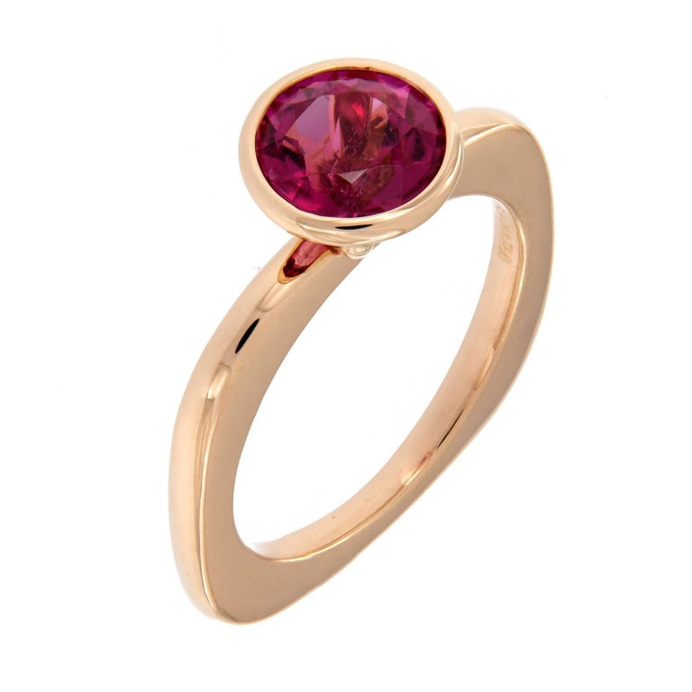 18k yellow gold Goshwara stackable ring from the Gossip Collection features a bezel set round brilliant rubelite and a rounded square shaped shank. Weighs 5.7 grams. Ring Size 6.25 Rubelite 2.07 ct