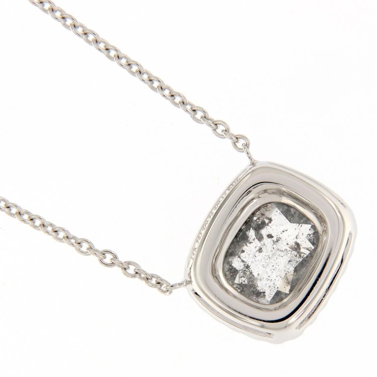 "Pretty diamond halo pendant features a 0.92 carat grey, ""salt and pepper"" cushion rose-cut diamond. Pendant is on a 18 inch 14k white gold chain. Chain loops at 17 and 16 inches also. Weighs 3 grams.  White Diamonds 0.13 cttw. Grey Diamond 0.92"