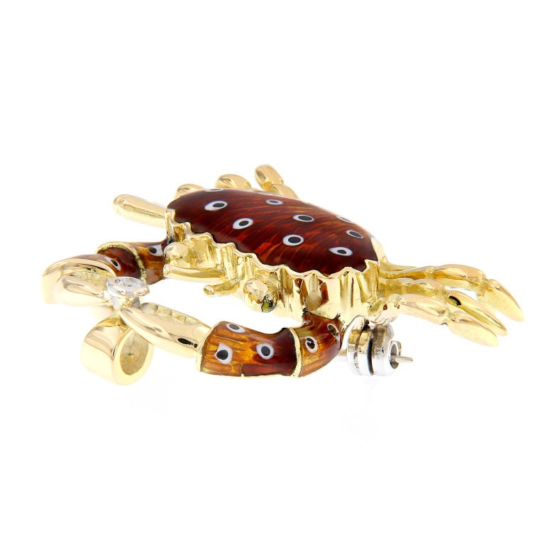 Beautiful crab brooch/pendant is crafted in 18k yellow gold made in Italy. Features a colorful enameled body and a bezel set diamond. The crab can be worn as a brooch or as a pendant. Weighs 10.3 grams.  Diamonds 0.03 carat