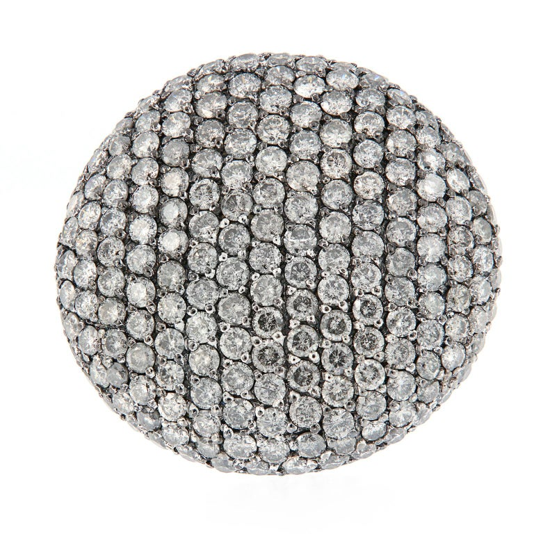 For those with an extra large fashion sense, this large oval dome ring is spectacular! This 18k white gold ring features 6.21 carats of fancy grey diamonds. Designed and created by Scheffel-Schmuck of Munich Germany. Ring size 6.75. Weighs 21.8