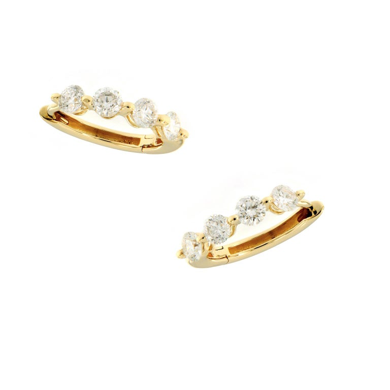Lovely diamond huggy earrings perfect for every day. Crafted in 18k yellow gold. Each earring has four round brilliant cut diamonds set in one shared prong. Weighs 1.7 grams.  Diamonds 0.59 cttw