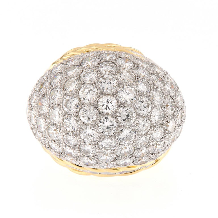 This epic estate ring is as fun as it is important. This beautifully crafted ring from Hammer Brothers of New York is truly a striking piece of jewelry. Showcasing almost eight carats of diamonds and rope design detail. The ring is crafted of
