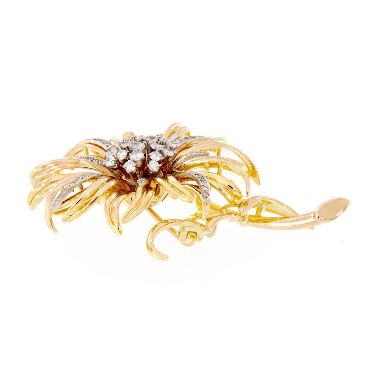 Pretty Intricate sunflower design crafted in 18k yellow gold accented with almost two carats of single and full-cut diamonds. This estate brooch is in like-new condidtion. Weigh 26.8 grams  Diamonds 1.85 cttw, SI-I1, GH