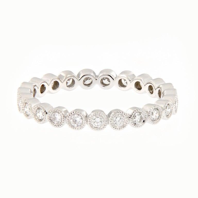 Women's Platinum Bezel Set Diamond Eternity Ring For Sale