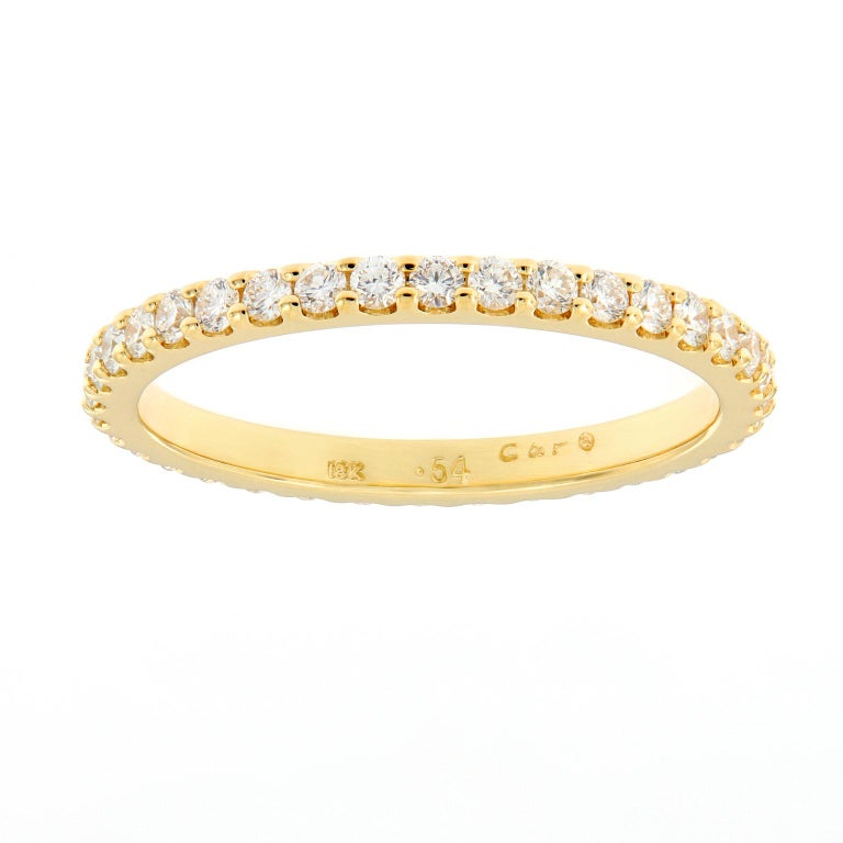 Ring is crafted in 18k yellow gold and is great for stacking and would also beautifully complement an engagement ring. Weighs 1.8 grams. Ring Size 6.  Diamonds 0.54 cttw