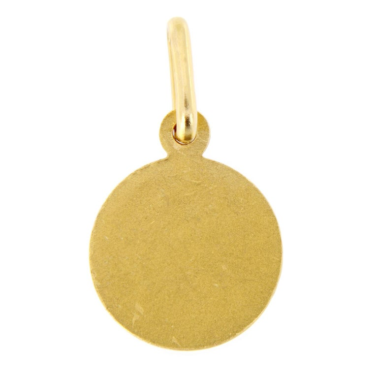This round Raphael thinking angel pendant is made of polished 18 karat yellow gold. Diameter: 8mm. Weighs 1.3 grams.