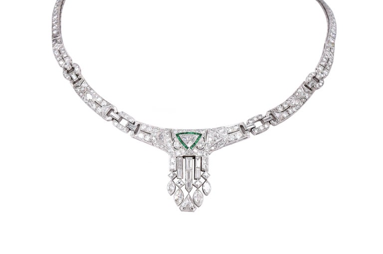 Elegant Art Deco diamond and emerald necklace.. It consists of 261 diamonds with approximate carat weight of 14.55carats .  There is 235 Old Eropean cut diamonds - about 11.50carats & 4 french and 17 baguette cut diamonds: approximately