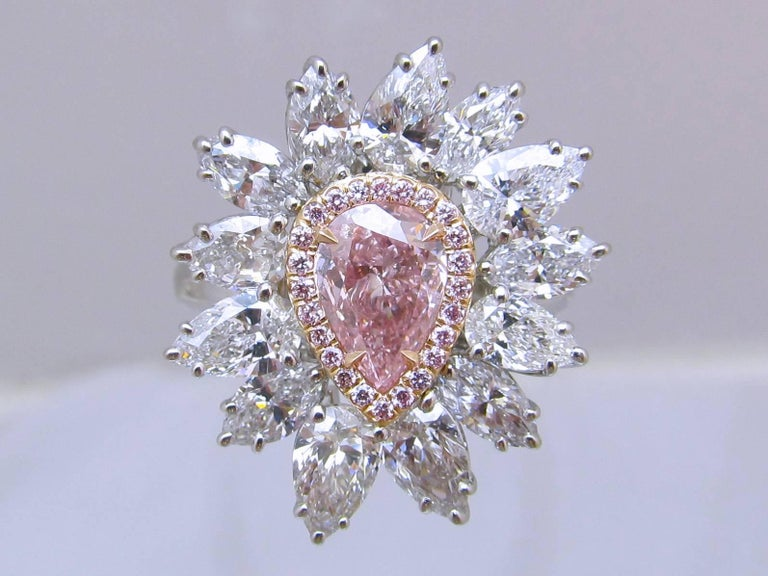 Nature's Wonder! Beautiful Intense Purplish Pink pear shape diamond is set in rose gold surrounded with 24 natural pink brilliant diamonds( total weight of 0.13 carats) then flared flower petals style with 13 top color pear shape diamonds ( total