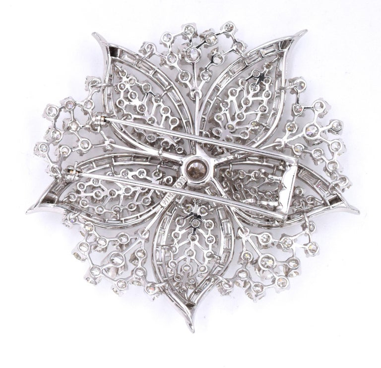 Harry Winston Diamond Flower brooch. This brooch has about 230 diamonds, including the center stone, weighting approximately 20carats , all set in platinum The center diamond is about 1.50carats.  Signed Winston.  Measurements: about 2.25 inches by