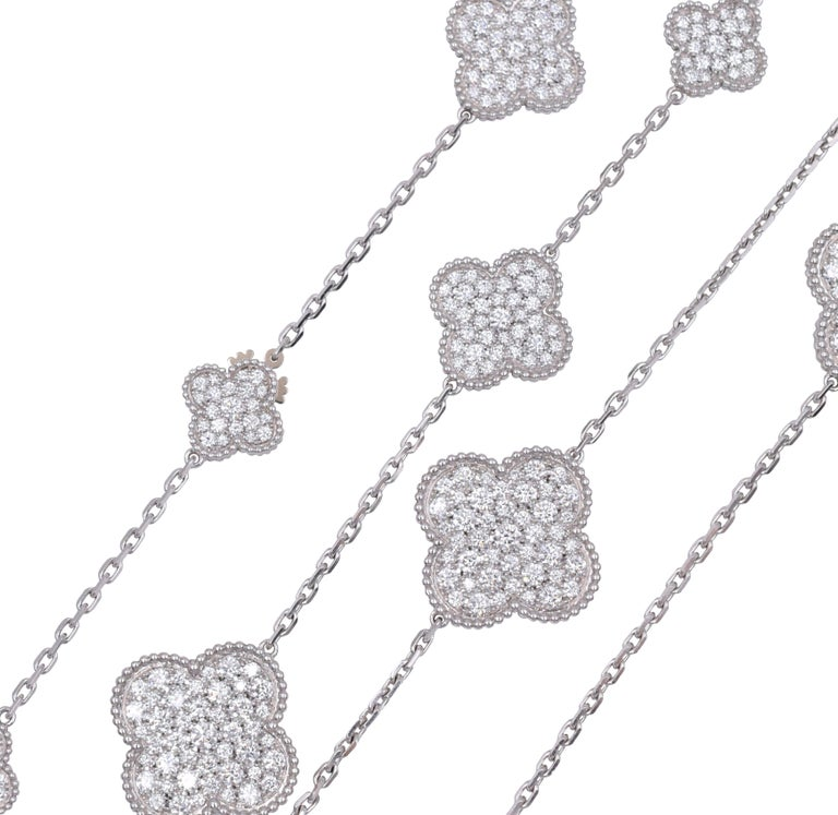 Van Cleef & Arpels Diamond Magic Alhambra Necklace This necklace has approximately 17ct of round brilliant cut diamonds all set in 16 motifs of 18k white gold. Signed VCA, Au750, JE165104.