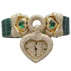 Graff Lady's Yellow Gold, Diamond and Emerald Heart-Shaped Wristwatch