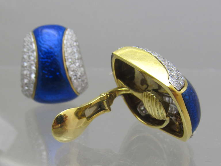 Beautiful royal  blue enamel cased in 18k yellow gold & surrounded with brilliant shape diamonds set in platinum.