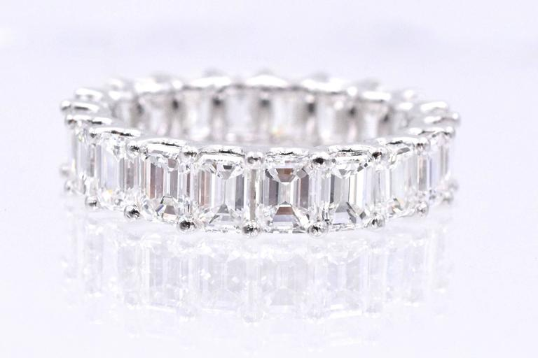 Elegant eternity band with  20 emerald shape diamonds set in platinum with common prong style and U shape shape gellery. Total weight of the diamonds is 5.40 carats and each diamond is 0.27 carat. The diamonds are F color,VS clarity Ring size: