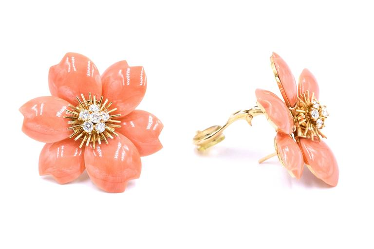 Beautiful coral color   Earrings by Van Cleef & Arpels Each of floral design composed of coral petals around clusters of brilliant-cut diamonds. Total diamond weight  1.00 carat.The earrings have post fittings French assay and maker's marks, Van