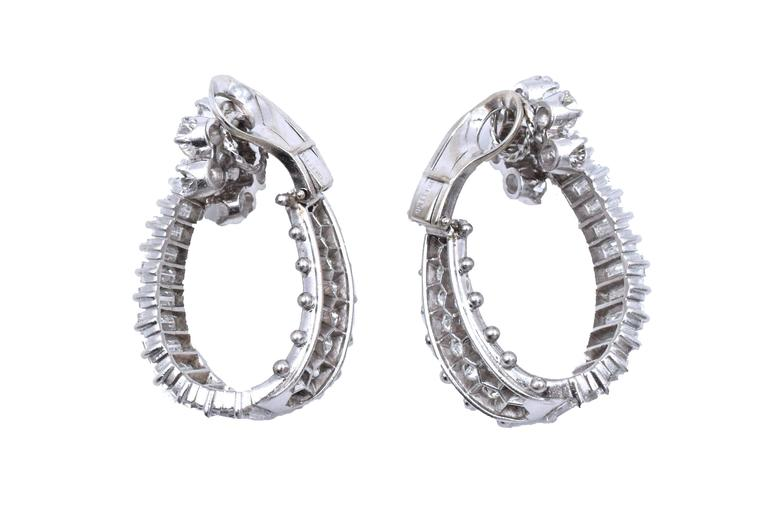 A Fine Pair of Platinum and Diamond Hoop Earclips,  containing 46 round brilliant cut diamonds weighing approximately 3.50 carats total and 28 baguette cut diamonds weighing approximately 4.50 carats total  Total weight of the diamonds is 8 carats