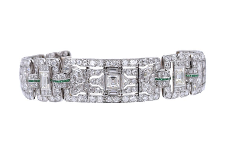 latinum, diamond and emerald bracelet,  Set with emerald cut diamonds weighing approximately 7carats and old european-cut, single-cut, baguette, marquise-shaped and triangular-shaped diamonds weighing a total of approximately 19 carats, accented by