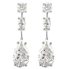 5.02 Carat Pear Shape & 5.23 Carat Pear Shape Earrings Set in Platinum Mounting