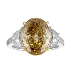 5.05 Carat Oval GIA Certified Set in Two-Tone Three Stones Ring