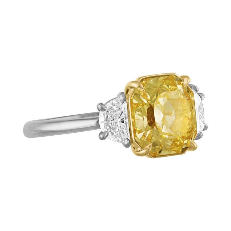 GIA Certified Fancy Yellow 4.09 Carat Cushion Cut Diamond Three-Stone Ring