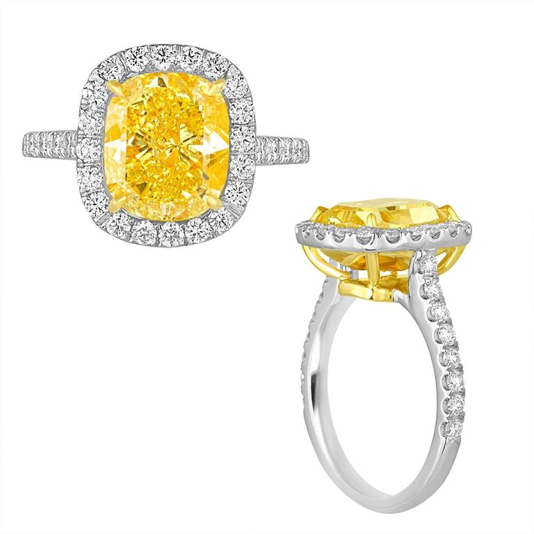 Contemporary 4.76 Carat Cushion GIA Certified Fancy Vivid Yellow Diamond Two Color Gold Ring For Sale