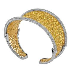 Fancy Shaped Yellow and White Diamonds set in Two Color Gold Bangle Bracelet