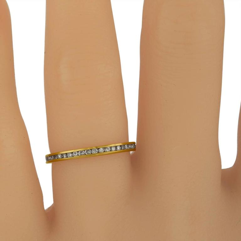 Yellow Gold Wedding band with 0.75 Carat Total Weight of Diamonds set all around in Basel Set Style.