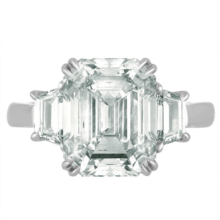 6.02 Carat Emerald cut Diamonds Certified by the GIA as I in Color and VS2 in Clarity. The Center Stone is set with Two Step Cut Trapezoids to match the Emerald Cut Diamond. The Trapezoids are 0.58 Carats Total Weight. Three Matching Diamonds are