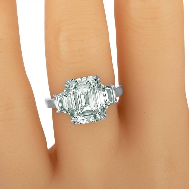 Contemporary 6.02 Carat Emerald Cut Diamond Set in Platinum with Trapezoids For Sale