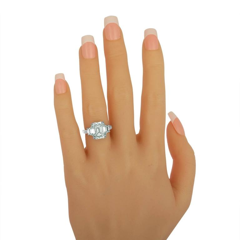6.02 Carat Emerald Cut Diamond Set in Platinum with Trapezoids For Sale 1
