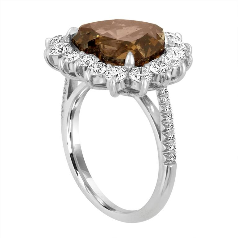 7.01 Carat Heart Shape Diamond, GIA Certified Fancy Dark Yellowish Brown is set in Platinum Ring mounting. The mounting is Hand Made One.