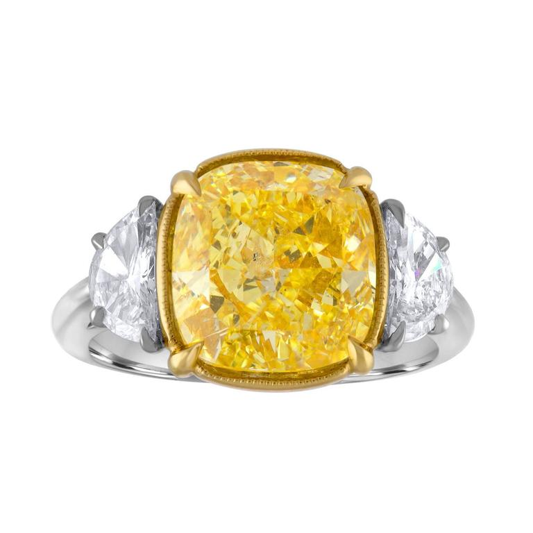 Beautiful Platinum and 18K Yellow Gold Hand Crafted Mounting. The Center is 5.04 Carat Cushion Cut Diamond which is GIA Certified to be Fancy Intense Yellow.  GIA Certificate Number is - 17217092.  The Center Diamond is set in 18K Yellow Gold . Two