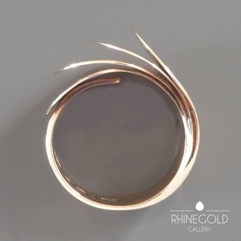 "1970s Urpo Kajander for Kaunis Koru Finnish Modernist Gold Ring 14k rose gold  Ring head 2.1 cm wide (approx. 13/16"")  Ring size: adjustable, current size: Ø 18.1 mm = EU 57 / US 8 / ASIA 16 Weight: 13.4 grams Marks: 'UJK', [Finnish national"
