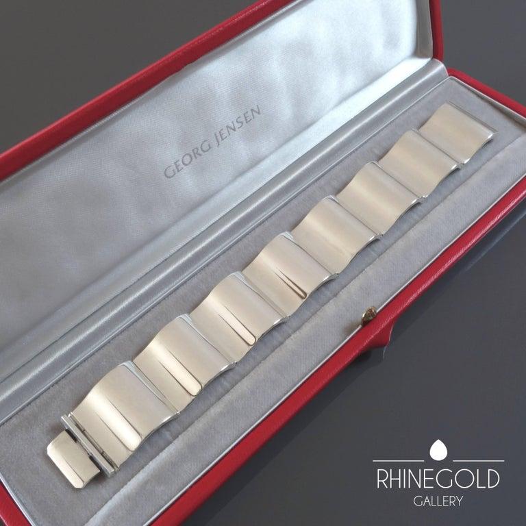"Nanna Ditzel for Georg Jensen: 'Surf' Silver Bracelet #432  Sterling silver Length (when closed) 18 cm (approx. 7 1 /16""), width 2.2 cm (approx. 7/8"") Weight approx. 77 grams Marks: '925S DENMARK'; 'GEORG JENSEN' in dotted oval; '432' Denmark,"