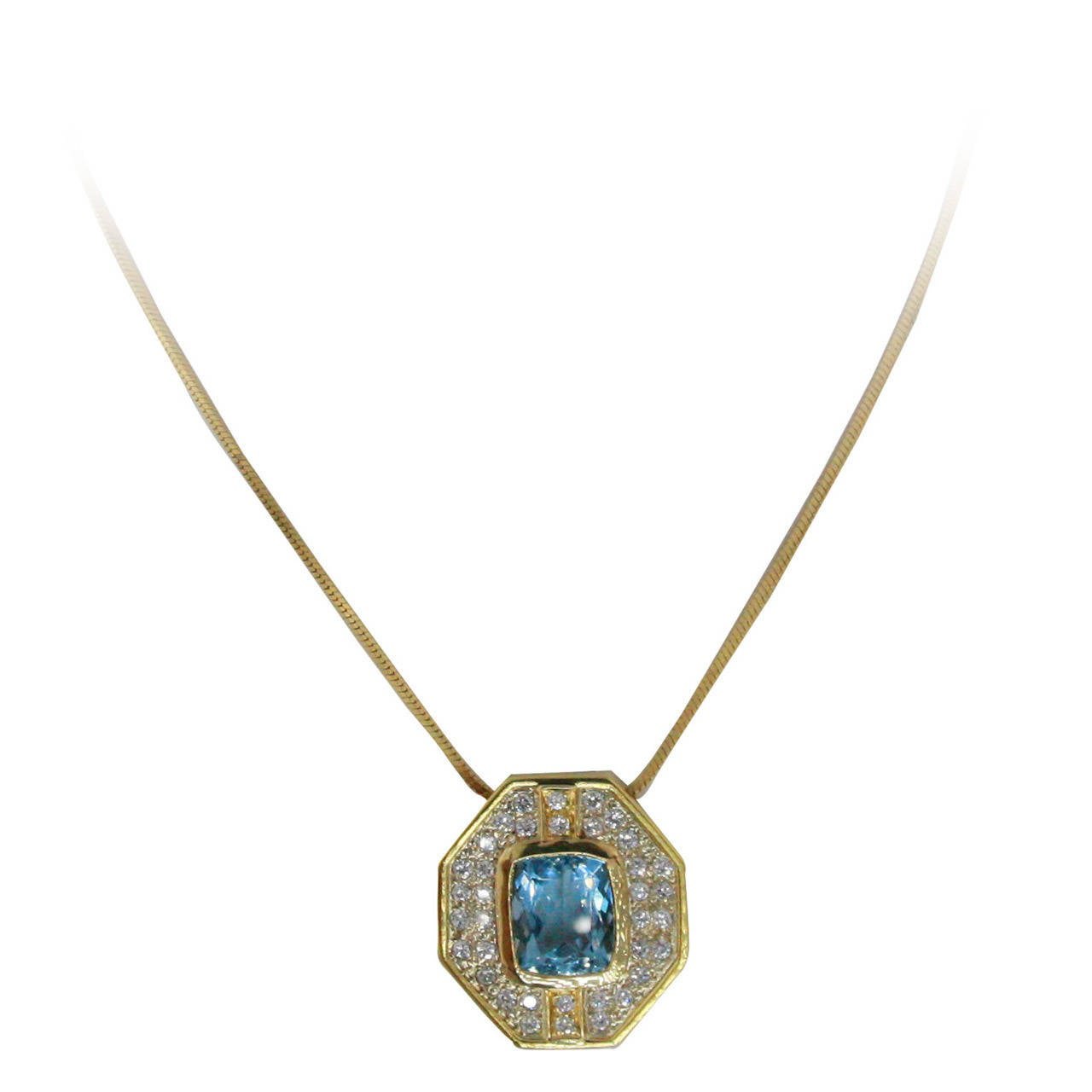 Pendant with 36 round diamonds weighing approximately 0.75 carats surrounding an Aquamarine measuring 12.5 x 9.5 mm with an estimated weight of 5.5 carats. Pendant is suspended from an 18 Karat Yellow Gold 16 inch chain.