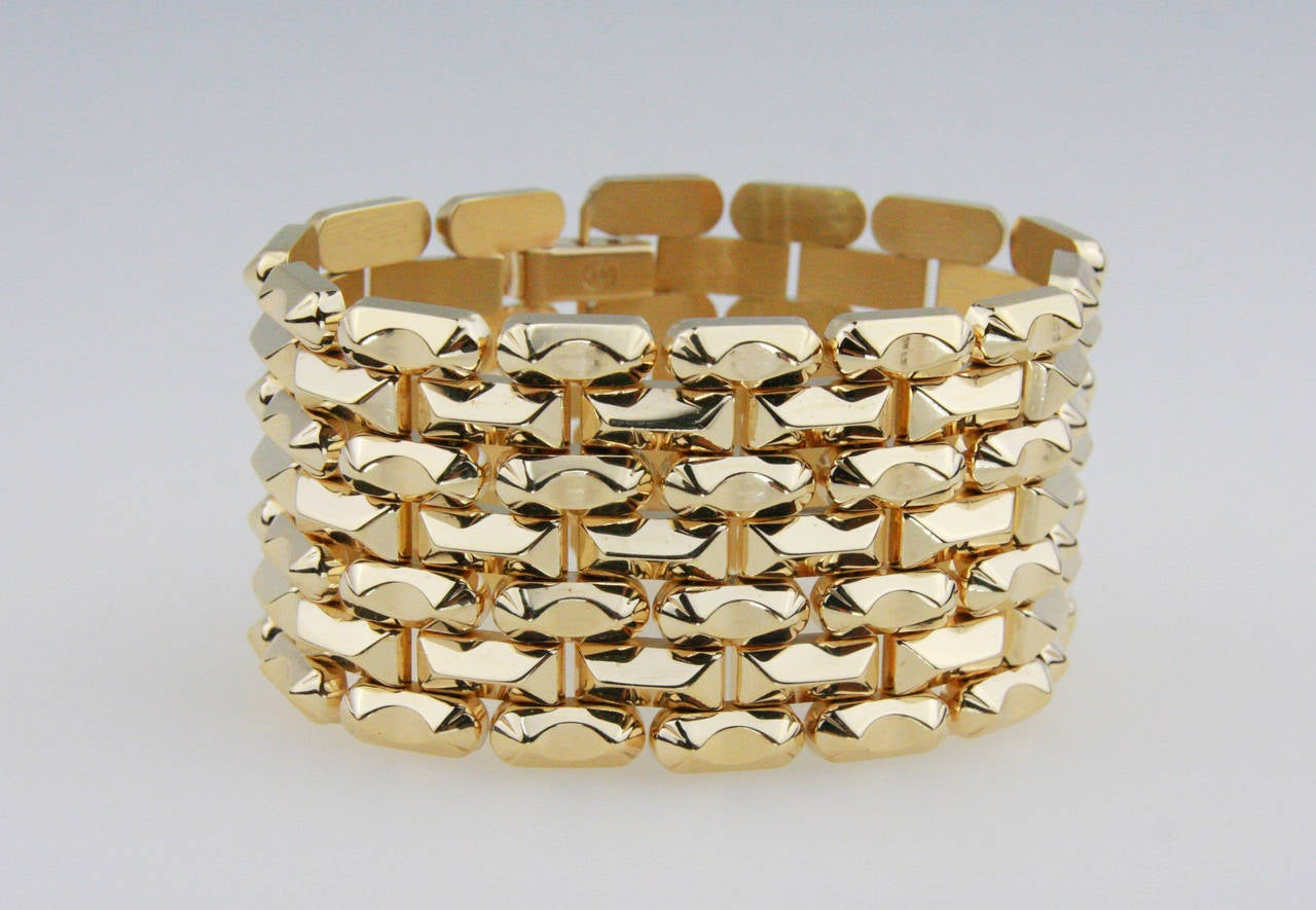 Retro bracelet in pink gold.  7 inches long and 1 3/8 wide. Hinged link design.  Metal Weight: 67 grams Metal Type 14 Kt gold.