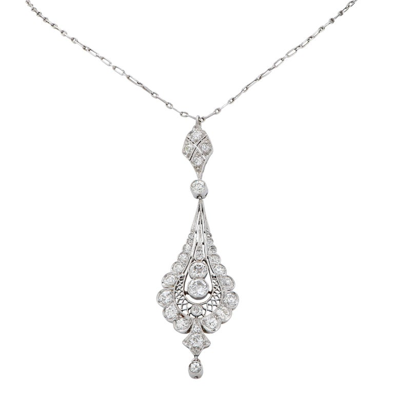 Edwardian Platinum and Diamond Pendant Necklace features 28 old European cut diamonds H/I Color, Si Clarity with and estimated total weight of 2 carats mounted on a platinum chain. Pendant is circa 1910 Chain Length: 16 Inces Metal Type: